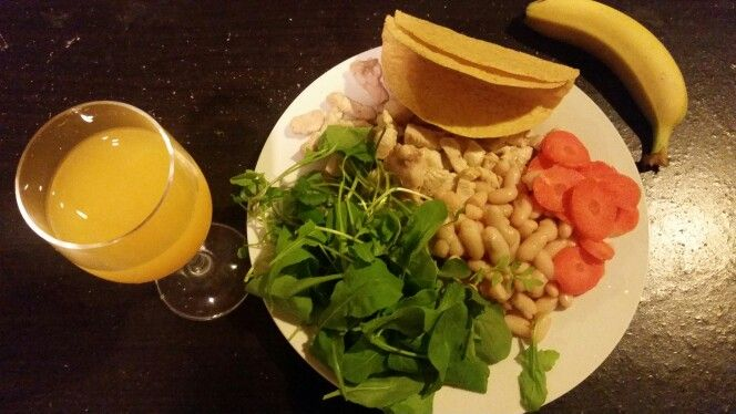 Mexican  tacos.  Baby rocket, watercress (optional), taco shells, beans (of your choice), chicken, carrots, 100% orange juice (optional), banana (optional) Tomato sauce or taco sauce can be used on top.
