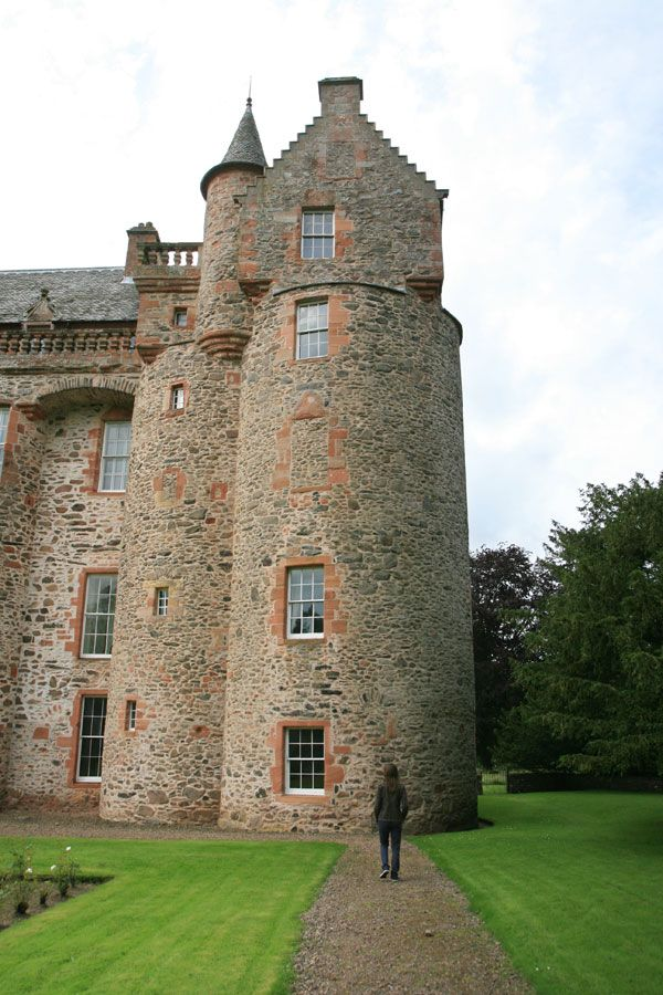 At the rear of Thirlestane Castle, the old round corner tower can be seen, more or less in its original state save for the addition, by Bruce in the 17th century.
