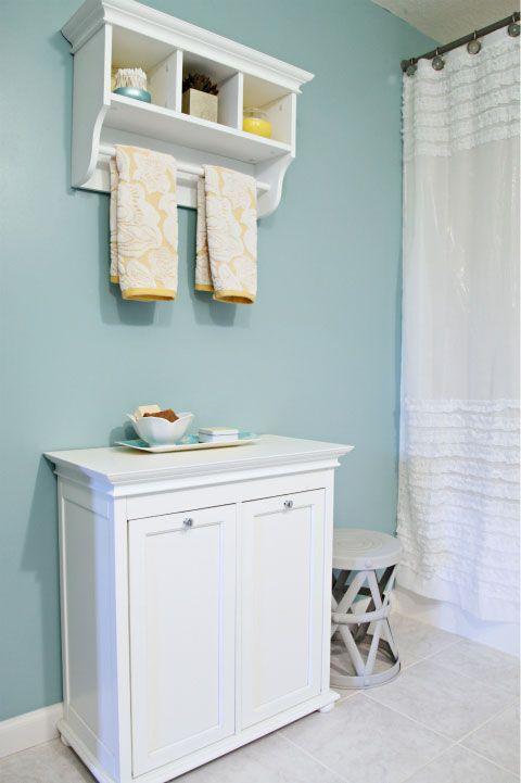Bathroom.  Love the towel bar and shelf unit.