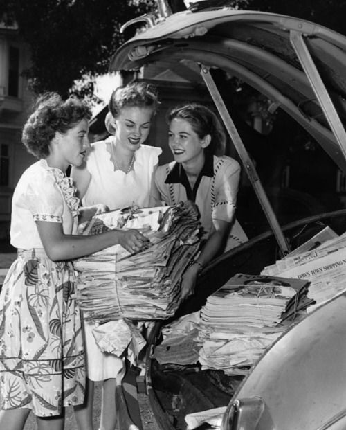 Marjorie Maxwell (right) accepts bundled papers and magazines from Miriam Franz (left) and Jo Neal (center). Marjorie will deposit the waste paper at an auto park in downtown from which they will taken and used for war production. dated - August 17, 1944