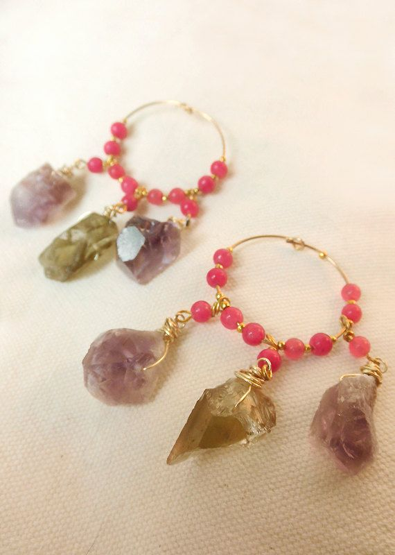 SOLD An amazing pair of 24K gold plated loop earrings filled with the energy of the Amethyst and lemon quartz crystals that they are hanging from them. Beautiful strawberry pink Jade gemstone beads and gold plated small beads are completing their image! A gorgeous pair of earrings that is upgrading your outfits! Is it yours?!... They are wrapped in a beautiful gift box and can be send to you or to whomever you like in 1-2 business days! For domestic shipping i use a courier service and for…