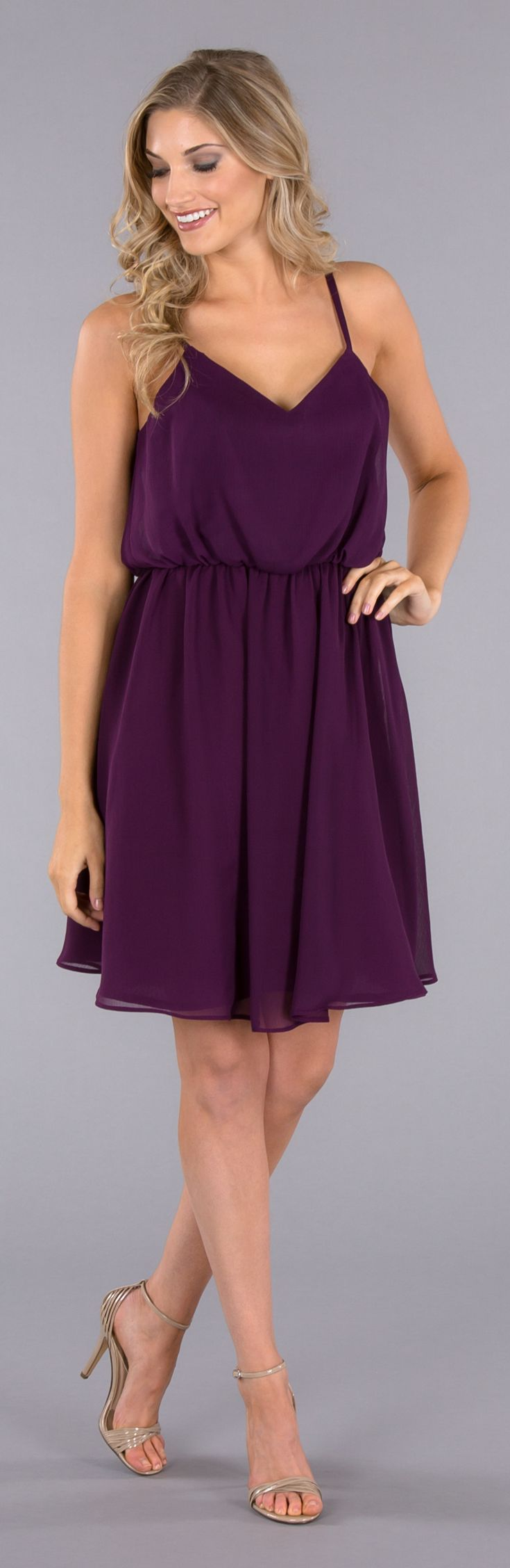 A short chiffon bridesmaid dress with a loose-fitting spaghetti strap top that your 'maids can wear over and over again!