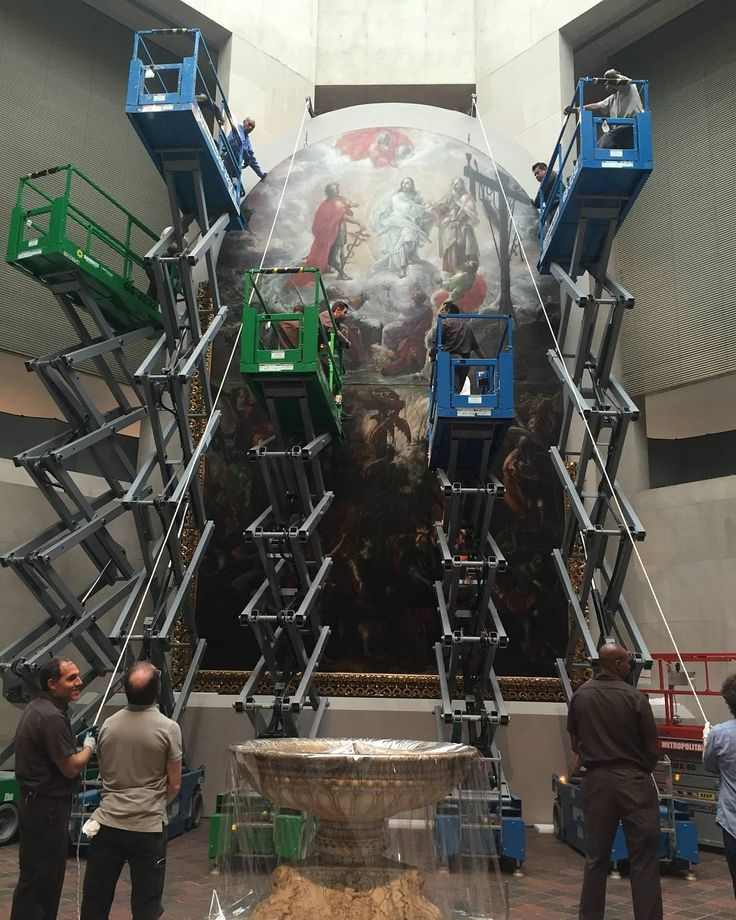 "Cristóbal de #Villalpando: Mexican Painter of the Baroque"" opens in the Lehman Wing next Tuesday, July 25. Here, riggers and technicians install Villalpando's masterful 28-foot-tall painting, ""Moses and the Brazen Serpent and the Transfiguration of Jesus."" The installation was done over five days and our team used as many as six scissor-lifts at once! #TheMet @fomentoculturalbanamex : @rjkasl"
