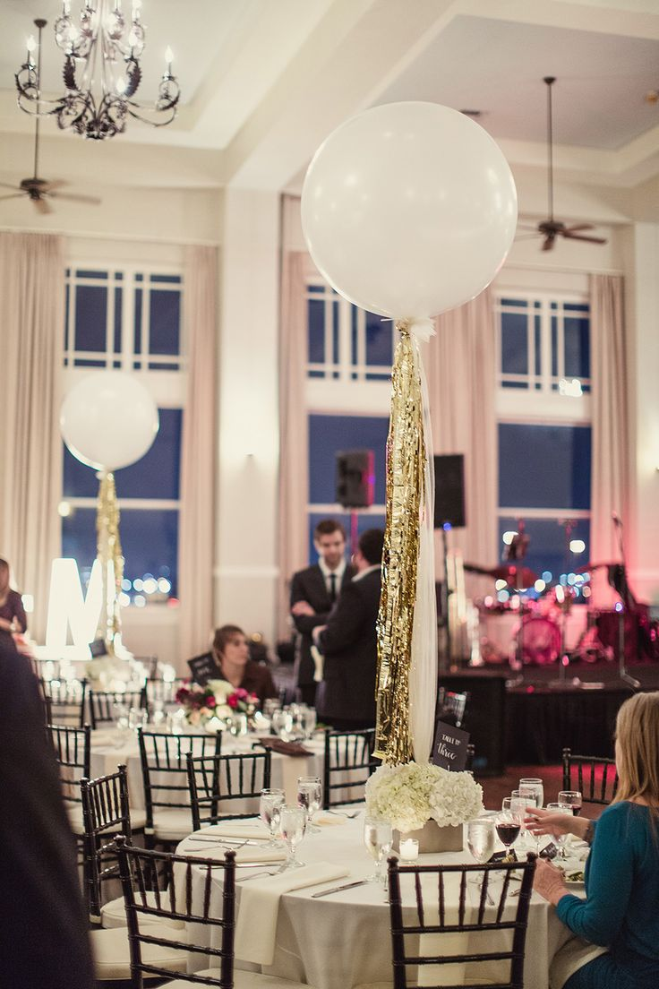 Extra large balloons with gold tassels make a darling and creative centerpieces.