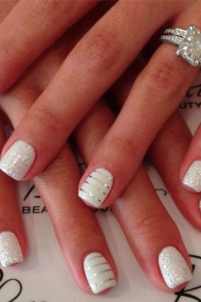 This subtle yet sparkly mani is so chic for a #bride! #bridalbeauty #nails