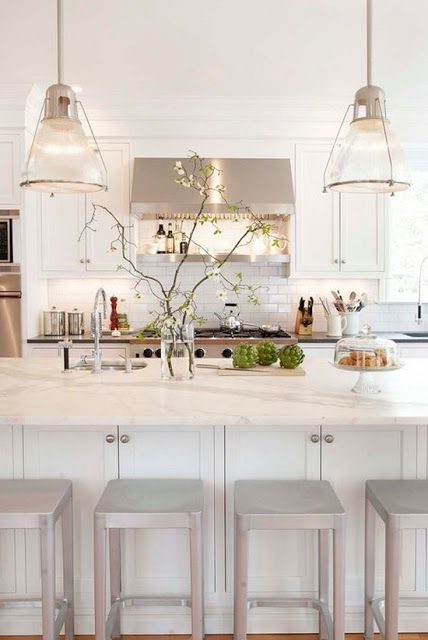 I love this so much, except that there are stools in front of functional cabinets. WTheck? I love the stools. Love the lights, the counters, the hood.