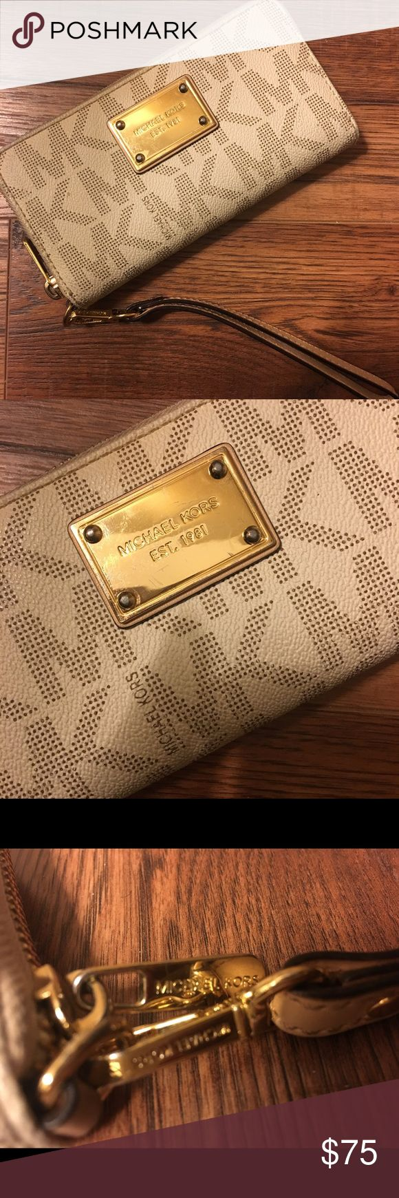 Michael Kors Jet Set Signature Continental Wallet Like new Michael Kors Signature 'MK' wallet w/zipper. Includes strap to wear around the wrist. 3 compartments including a internal zipper for change. Interior lined w/leather and MK logo. Excellent condition, no stains etc. Michael Kors Bags Wallets