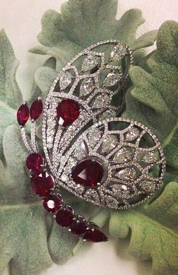 A Burmese pigeon blood ruby and diamond butterfly brooch