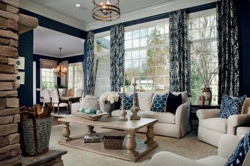 This navy and ivory living room is STUNNING!  I love the pops of blue, the stone fireplace and the soothing colors!