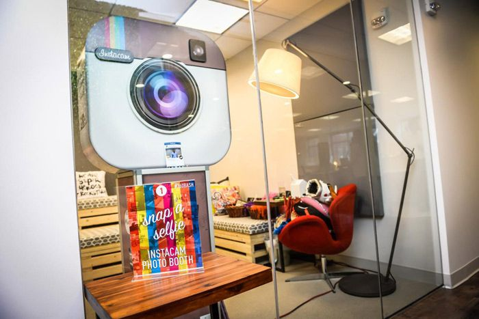 <p> The first stop for guests on the office tour was a photo booth from Instacam, and guests could pose...