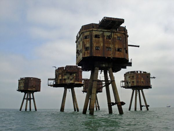 Six miles offshore from Suffolk, England are a number of sea forts on stilts clad in rusted metal and accessible only by boat. The forts were re-occupied in the mid-1960s for pirate radio. All forts are currently abandoned except for one which is known as the Principality of Sealand. The Bates family has claimed the fort tower as their own, and self-proclaimed the fort a nation state and deemed his family to be royalty.
