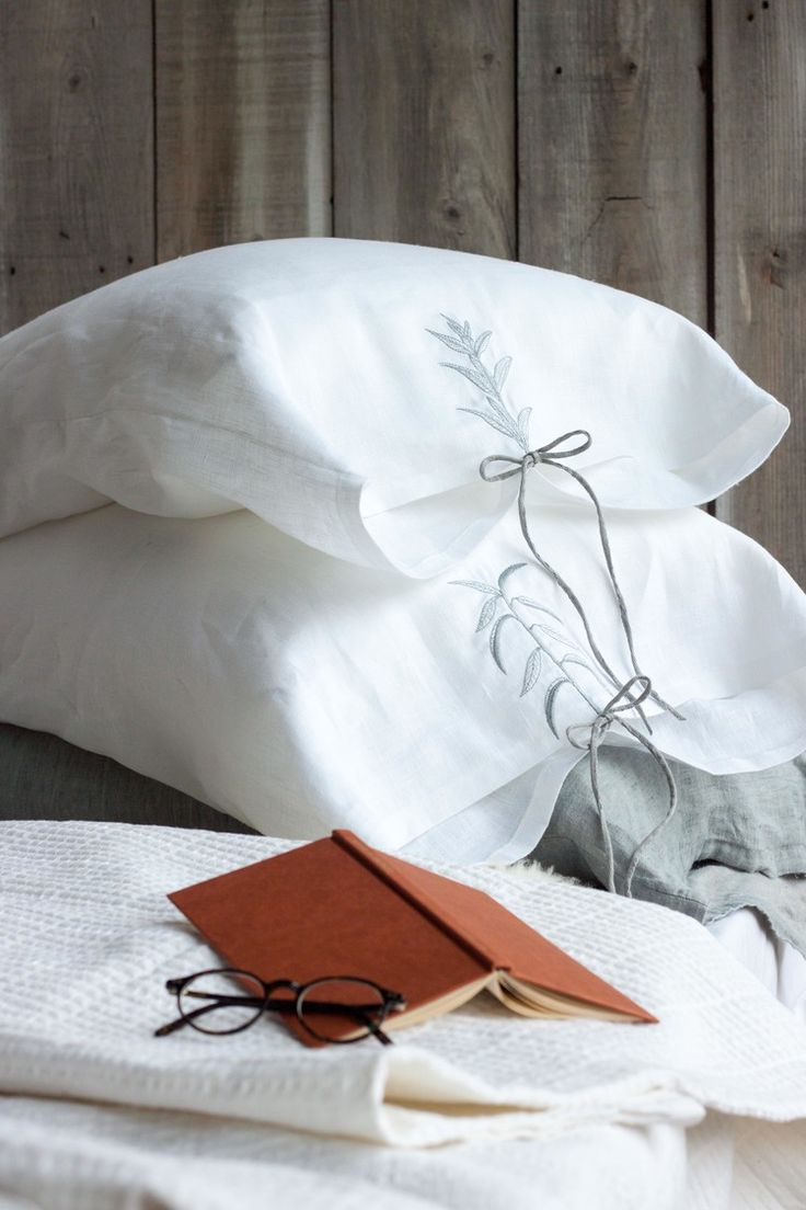 embroidered pillowcase set  Carefully made in Canada from pure linen, featuring embroidered plants inspired by vintage educational illustrations. The plant on each pillowcase is unique, displaying one deciduous and one whorled leaf arrangement.