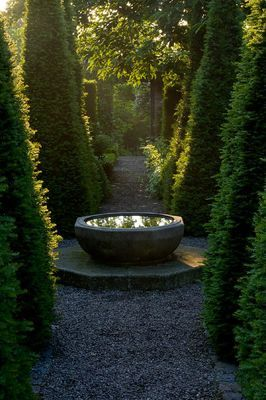 view through the topiary at wollerton old hall, shropshire......I would like this garden bowl please.