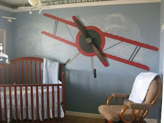 I painted an airplane on the wall with clouds behind it and the mounted a wooden propeller on the plane