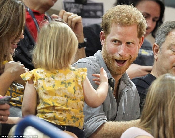 With no concern for the swarms of photographers watching, Harry delighted the little girl with funny faces throughout the event