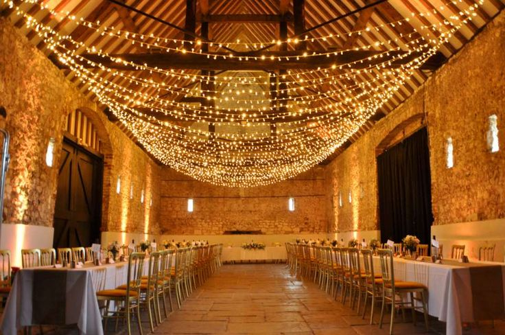 Widthways fairy light canopy in the Monks Barn Hurley, with warm white bulbs and gold uplighting