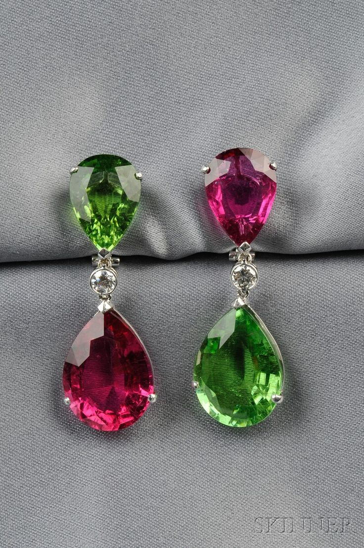 Sale 2575B, Lot 407   Pink and Green Tourmaline Earpendants, with alternately set pear-shape pink and green tourmalines, approx. total wt. 50.00 cts., joined by bezel-set full-cut diamonds, platinum and 18kt white gold mount, lg. 1 3/4 in.   Sold: $16,590.00