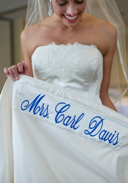 Sewing your married name in blue onto the hem of your dress. Make sure it is upside down so when you lift your hem (like pictured) the writing will be right side up!