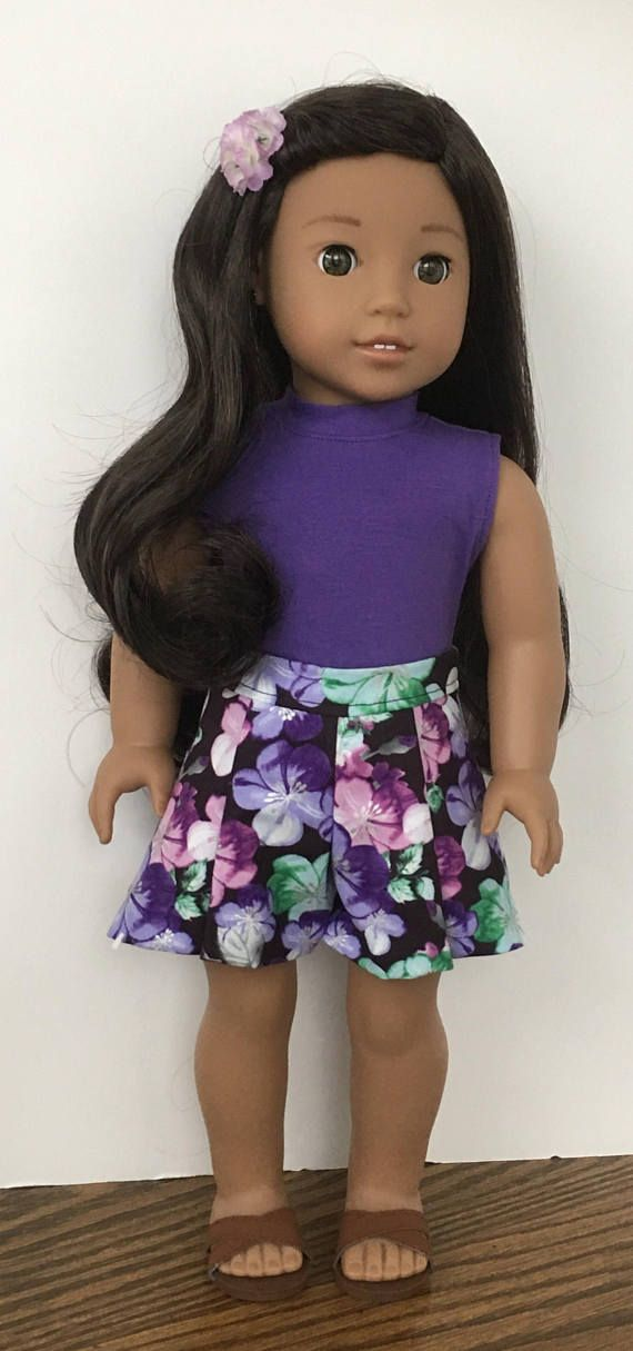 A bright outfit for your doll. The purple sleeveless tshirt has a neckband that is topstitched in purple thread. The shirt closes in back with Velcro. The culottes are a floral cotton fabric with a black back round. There are two pleats in the front. The culottes close in back with