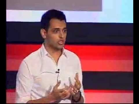 """Invisible Computing - Sixth Sense Technology from the 31 year old computer """"designer"""" Pranav Mistry. The research assistant at MIT showed the attendees how data can be sent/copied from one device to another by touching the first device, and then touching the second device."""