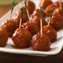 A simple meatball appetizer recipe prepared in a slow cooker with Manwich and jelly