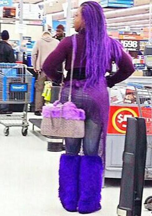 Things People Wear in Walmart. - Funny Pictures at Walmart--she definitely likes to Roche the purple.  Wow!