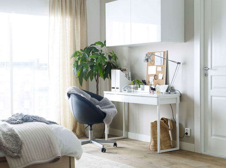 A clean, white study desk that can fit seamlessly into your bedroom