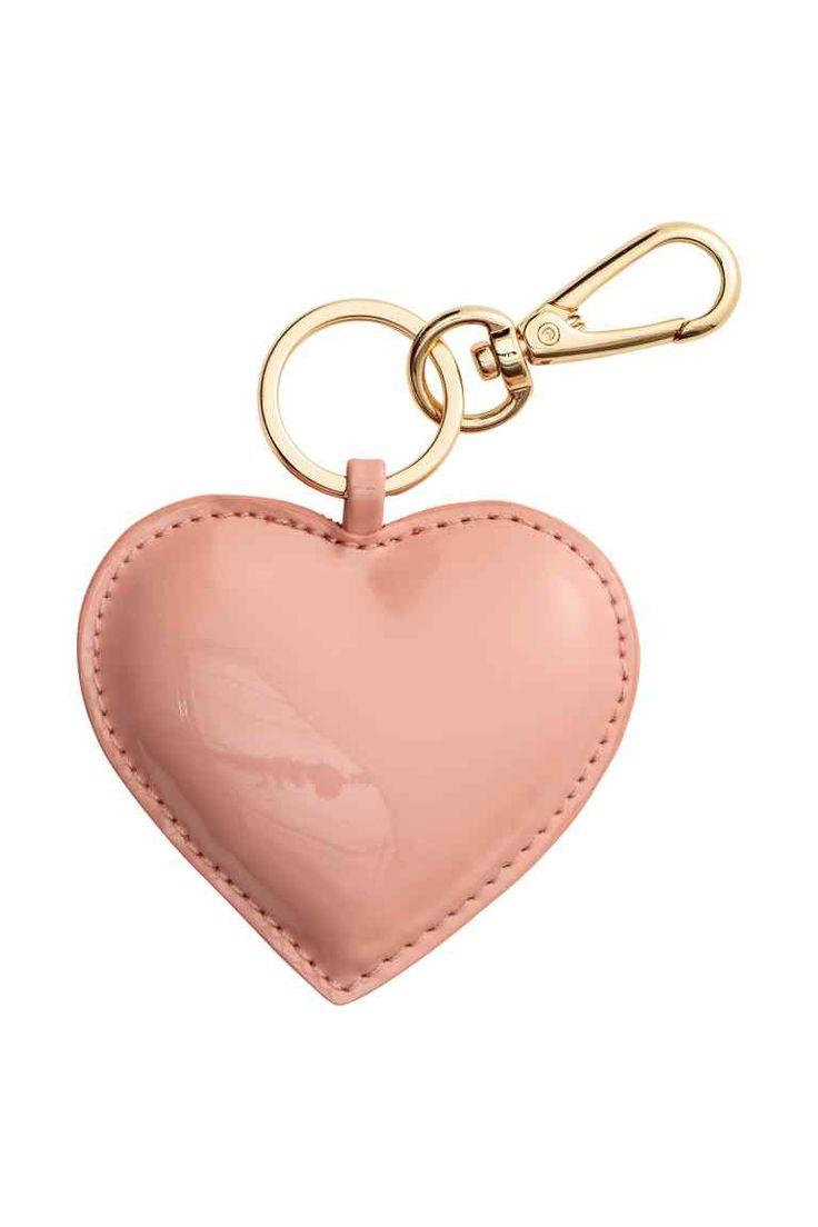 Porta-chaves: Porta-chaves em pele sintética com fecho mosquetão em metal.