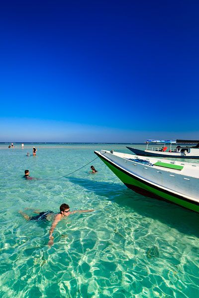 Tourist boats in the crystal clear waters around the small sand bar known as Gosong Seloka, located within the Marine National Park of Karimunjawa or Karimun Jawa, which translates as a stone's throw from Java.