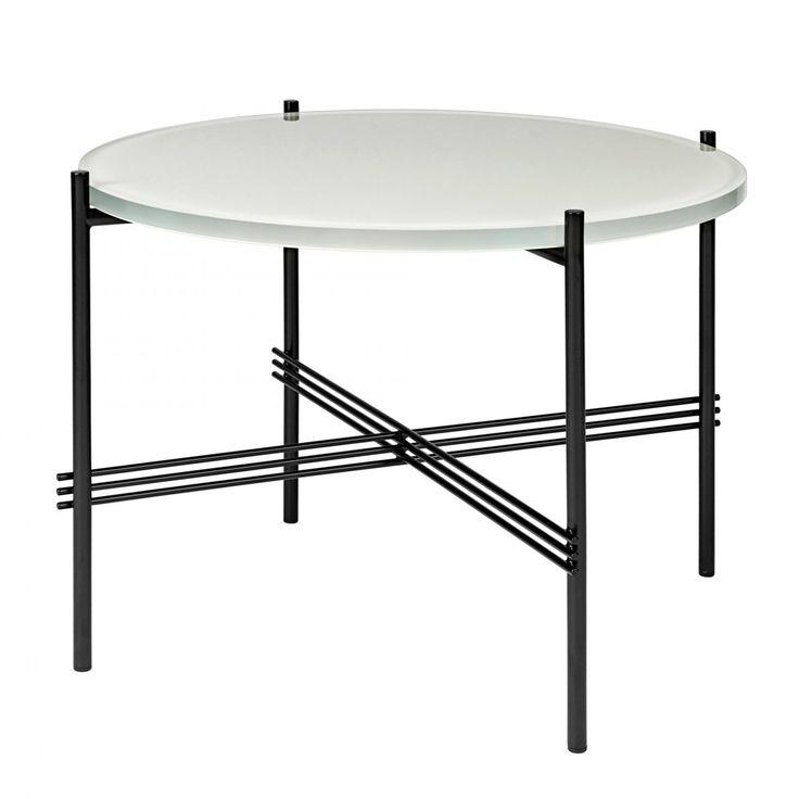 """TS Coffee Table Glass, soffbord i glas och stål formgivet av GamFratesi för Gubi. En kraftig skiva av färgat glas vilar på ett nätt ställ av pulverlackerat stål. Välj mellan sex vackra färger på bordsskivan. Ts Table visades för första gången under hösten 2014 på mässan Maison & Object i Milano, där det utsågs till """"Årets bästa design"""" av inredningsmagasinet Plaza Interiör.I kollektionen TS Table finner vi tre olika sideboards, ett sidobord, ett skrivbord, matbord och soffbord ..."""