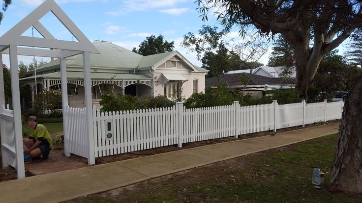 Cathedral Style picket fence with Arbor and pyramid capitols