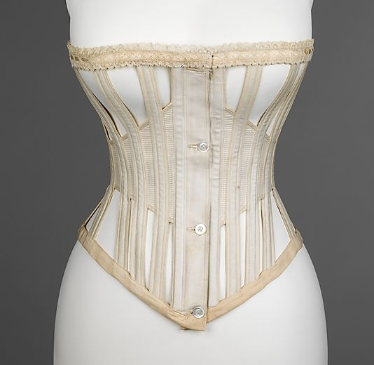 Corset - American 1864-1950  This skeleton-like corset is unique in form, for it is lighter and less restricting. The open spaces make it a cooler and comfortable choice for warmer weather. Most likely, this corset would be worn with casual day wear, due to its simplicity, the only detail being the lace trim at top.
