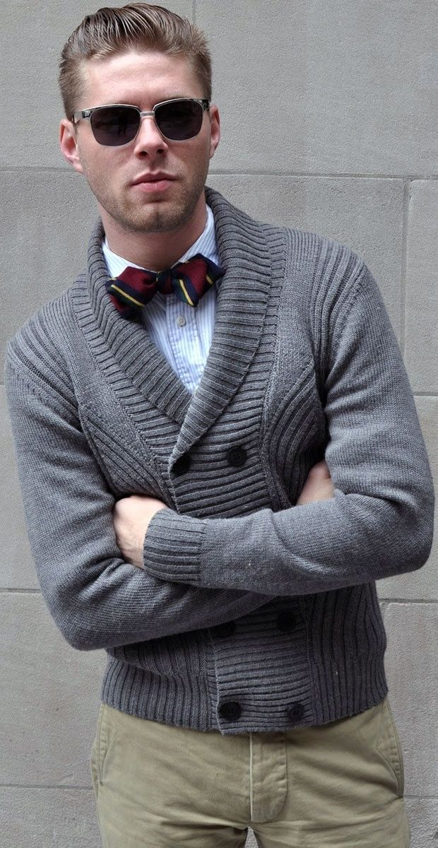 Shop this look on Lookastic:  https://lookastic.com/men/looks/shawl-cardigan-long-sleeve-shirt-chinos-bow-tie-sunglasses/6037  — Black Sunglasses  — Burgundy Vertical Striped Bow-tie  — Light Blue Vertical Striped Long Sleeve Shirt  — Grey Shawl Cardigan  — Khaki Chinos