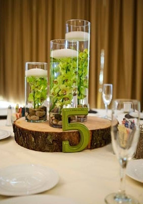 natural themed floating candles, tree trunk base ...