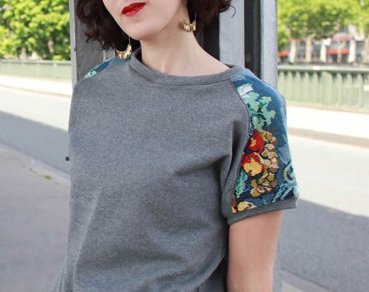 Very elegant way to refashion a sweat shirt. Add cross stitch fabric on shoulders make short or long sleeved