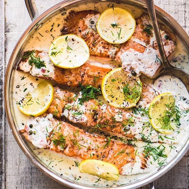 Creamy Lemon Dill Salmon ~ an easy dinner that never fails to please.  The salmon is succulent because it's bathed in a creamy wine sauce perked up with lots of lemon juice and fresh dill! clickable linkinprofile @thefeedfeed #salmon #salmondinner #lemon #dinnerideas #instayum #delicious #foodie #foodlovers #foodgawker #glutenfree #easydinnerideas https://theviewfromgreatisland.com/creamy-lemon-dill-salmon/