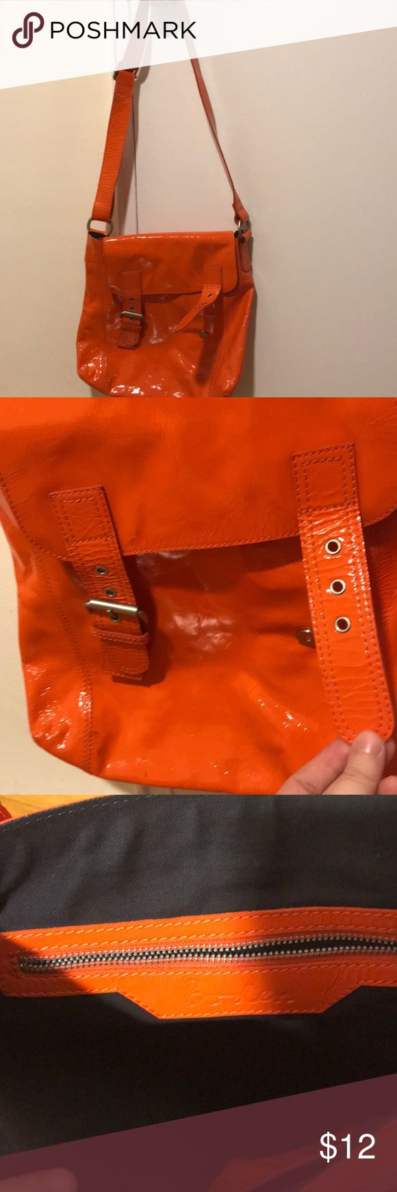 Boden Patent leather orange bag AS IS Beautiful bag! However major flaw - connector for magnetic closure on right side is missing. Can remove other side for symmetrical look, or wear without. Otherwise mostly cosmetic flaws, many small blemishes throughout. Exterior is extremely clean. Vibrant orange color! Boden Bags Crossbody Bags