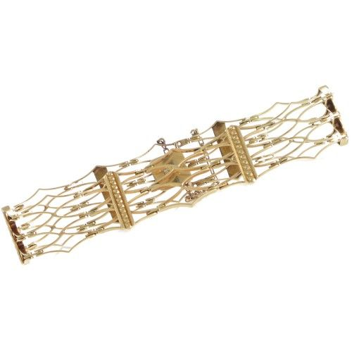 An 18ct yellow gold gate link style bracelet made as sets of three-wide long kite shaped frames articulated around the piece every second set with a fine gold bar overlaid for detail. #Rutherford #Melbourne