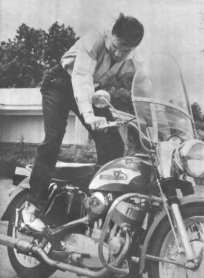 Harley Davidson & Elvis-made my heart leap! Could anything be sexier than a man straight leggin' a Harley? Only if that man is Elvis trying to kick that Harley over~~