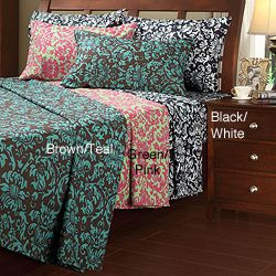 @Overstock - A dynamic floral print highlights this contemporary sheet set. With a fully elasticized fitted sheet and smooth microfiber construction, these sheets are finished with a 4-inch cuffed I LOVE THE green and pink!