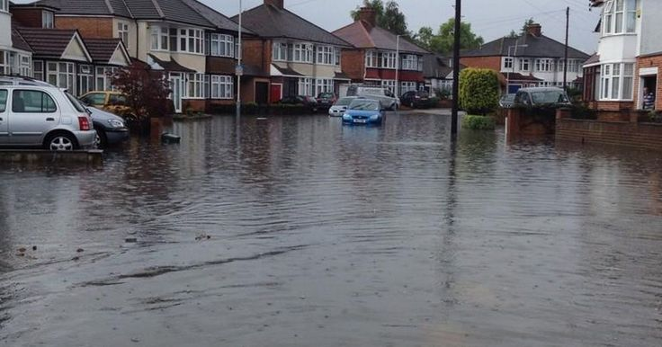 London (Hillingdon) 2014 - Some amazing scenes as the floods hit Hillingdon borough causing traffic chaos and leaving some stranded in their homes