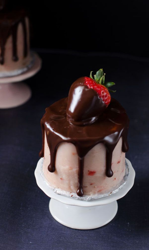 A recipe from @cakemerchant for 2 small chocolate layer cakes with strawberry frosting, chocolate ganache, and a chocolate dipped strawberry.