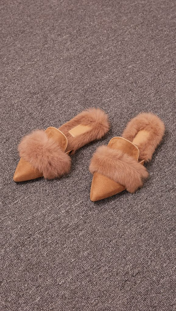Yulie Furry Slide in Brown Shearling. Shearling mule, created entirely with faux ribbit fur. Slide loafers with a almond square toe, padded leather foot bed and rubber soles. Slip on.