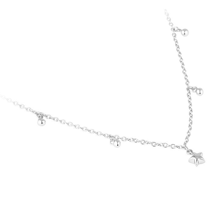 Star Necklace. A tiny sparkly star and beads provide delicate hints of detail on a fine silver chain. Perfect for layering and for those who treasure modern lux. Finely crafted in sterling silver. Click to shop on website.