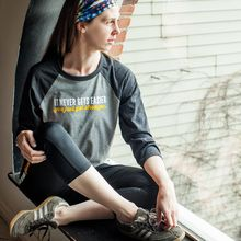 It never gets easier you just get stronger - baseball shirt. You'll love this baseball tee! It's made with a super soft blends of combed and ring-spun cotton, a modern fit, three-quarter contrast raglan sleeves and crew neck with contrast trim. Unisex sizing (S-XXL)