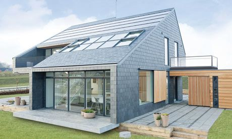 an ultra efficient house in Denmark that captures more energy than an average family needs to heat and power it.