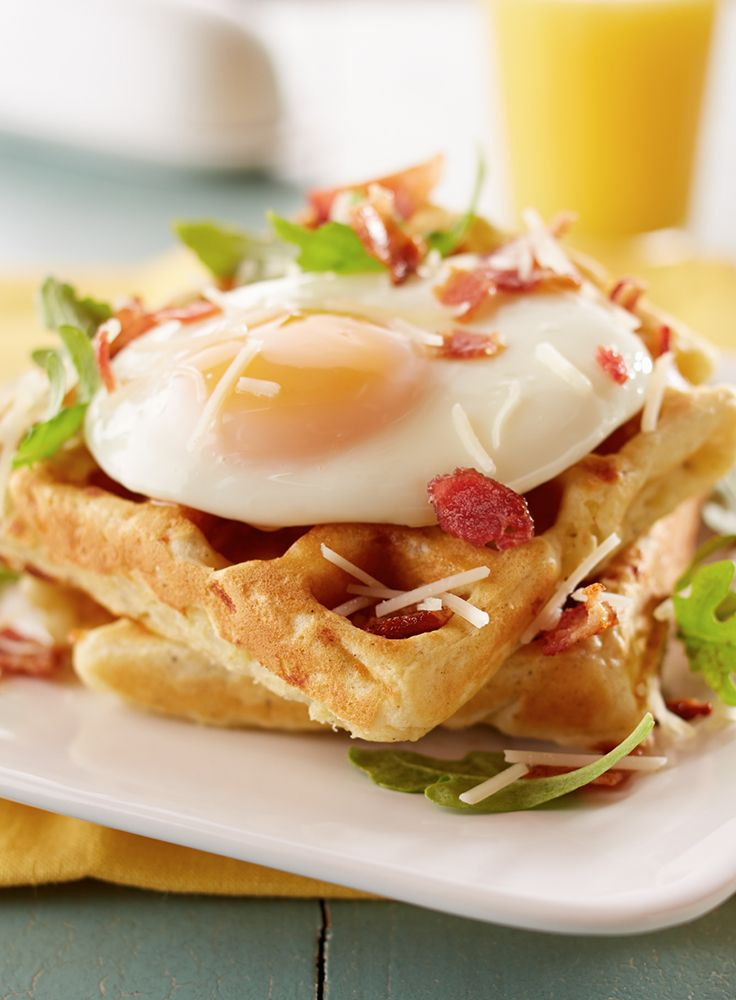 Parmesan Potato Waffles - A five-star brunch recipe. Savory potato waffles topped with a fried egg, arugula, bacon crumbles and lots of butter.