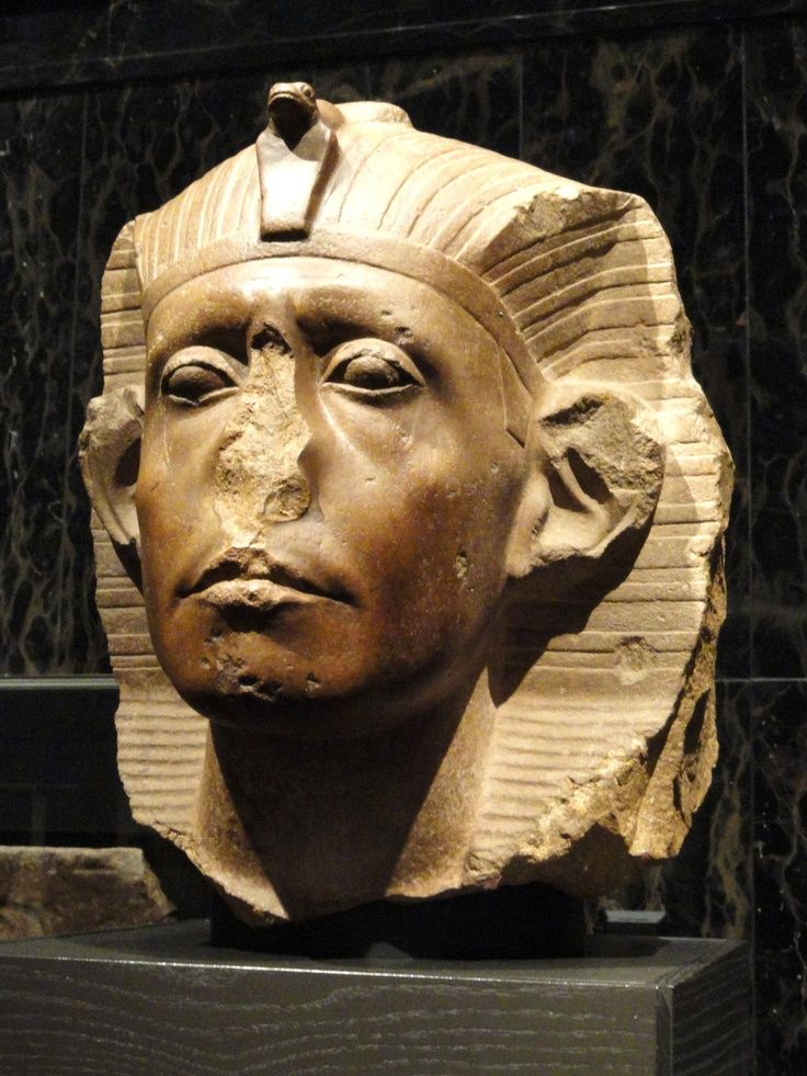 (fig 3-13)  HEAD OF SENUSRET III - Twelfth Dynasty, c. 1836-1818. BCE. Expresses the hardship and fragility of human existance. The statue seems to capture a monarch preoccupied and emotionally drained from the sight of the sagging cheeks, his sunken eyes, and his tense forehead. He was an all around king, very successful king, he lead four military expeditions into Nubia and regained control over the country. (yellow quarzite) (pg 62) LS edited by cwc