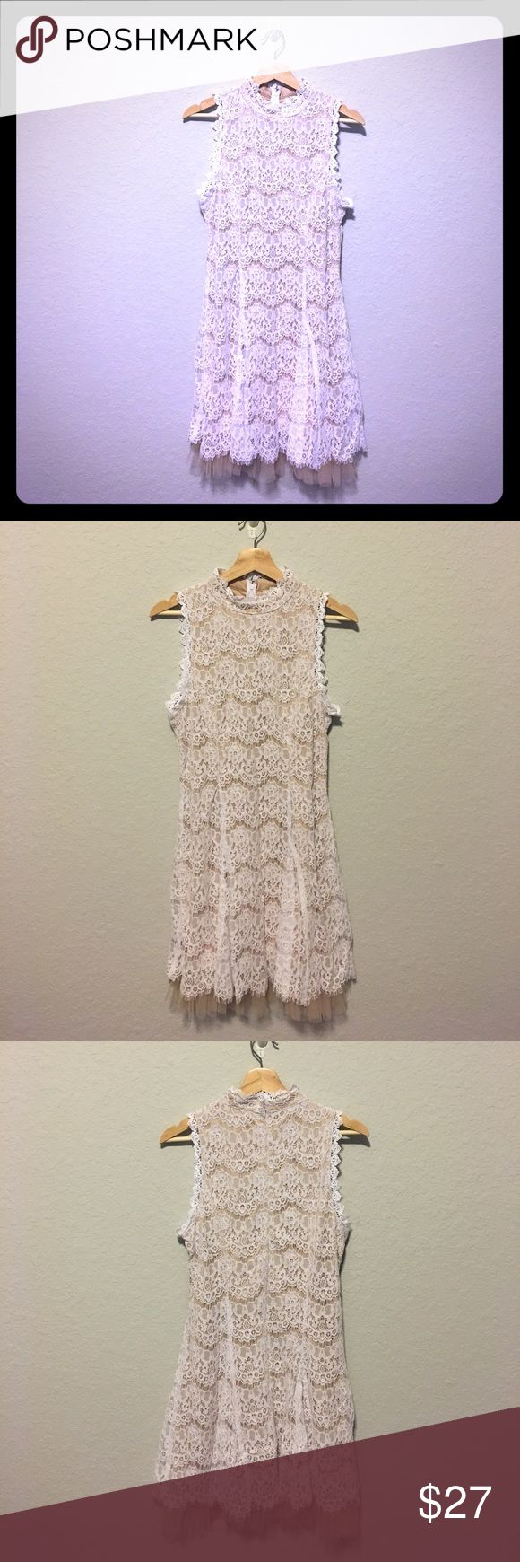 Delicate White Lace sleeveless Dress Lovely and feminine white lace sleeveless dress from Francesca's. Nude lining with Lace overlay. High collar detail. New with tags!!! Perfect for afternoon tea! Size Large, Should to Hem is 36 in Francesca's Collections Dresses