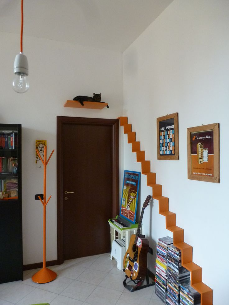 Our very own catification project, made putting together Leroy Merlin's cd shelves to form a staircase http://www.leroymerlin.it/catalogo/mensole/mensola-zig-zag-bea-arancione-56-x-16-cm-34802320-p